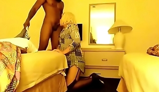 Sissy Crossdresser gives head, gets rimmed, and gets fucked by big dick alongside hotel room