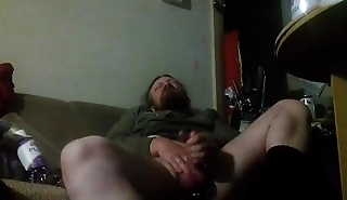 Slapping my penis against my hand. I am trying to milk my full balls