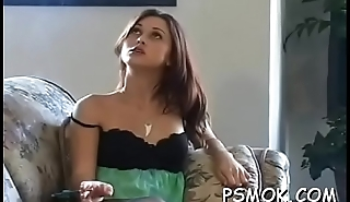 Older slut holding a cigarette and playing with herself